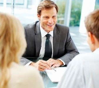 Happy leader executive discussing with his associates